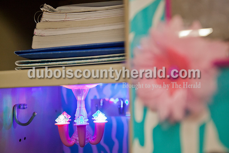 Rachel Mummey/The Herald<br /> A mini chandelier hung from the top of Jasper Middle School seventh-grader Caroline Gadlage's locker on Wednesday. Gadlage decorated her locker with wallpaper, flowers and photos of her animals.