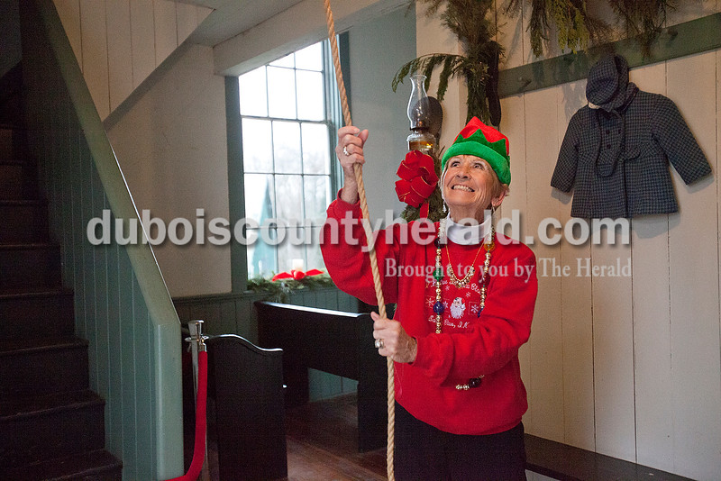 Rachel Mummey/The Herald<br /> Pat Koch of Santa Claus rung the bell at the 1880 Santa Claus Church before a performance by The Girls' Jazz Choir from Heritage Hills High School in Santa Claus on Saturday.