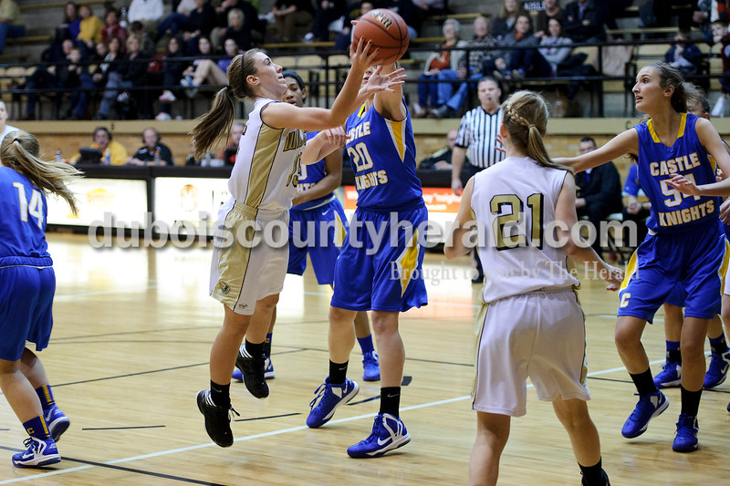 Jasper's Allyson Lents shot the basketball against Castle defender Rebecca Nunge during Thursday's game. Matthew Busch/The Herald