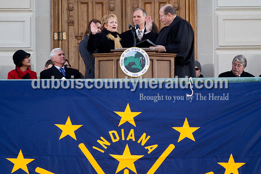 Rachel Mummey/The Herald<br /> Lieutenant Governor Sue Ellspermann was sworn in during the Gubernatorial Inauguration by Chief Justice Brent Dickson while accompanied with her husband Jim Mehling of Ferdinand at the State Capitol Building in Indianapolis on Monday. Also sworn into office was Governor Mike Pence, seated to the left, with his wife Karen, and Attorney General Greg Zoeller, seated to the right.