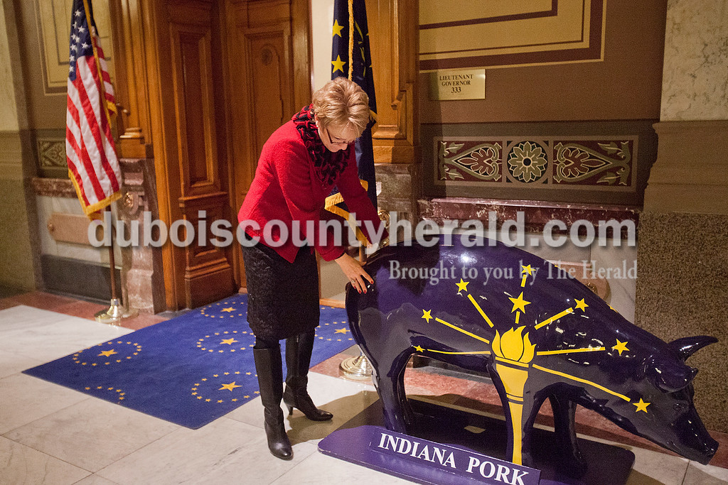 Lieutenant Governor Sue Ellspermann adjusted the placement of a pig statue outside of her office at the State Capitol on Jan. 13. As  Lieutenant Governor, she is secretary of agriculture and rural affairs, and oversees the Office of Tourism Development and Office of Energy Development.