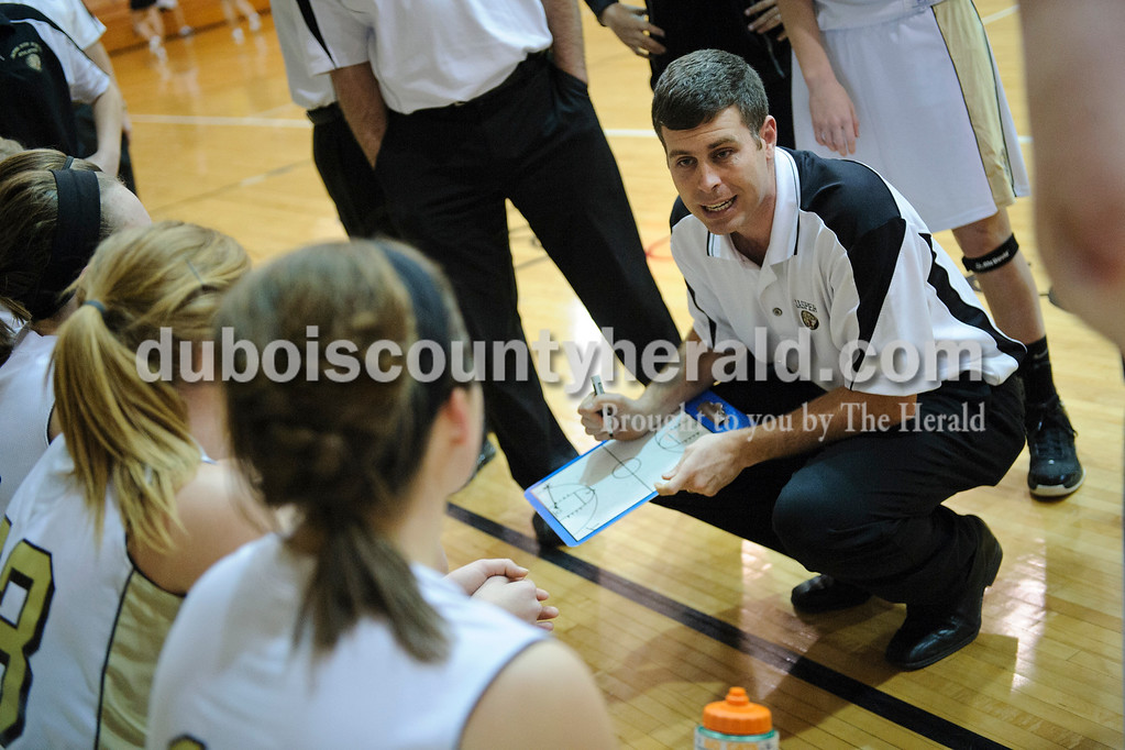 Jasper girls head coach Ryan Erny coached his team on the sidelines during a timeout during Thursday's game against Castle. Matthew Busch/The Herald