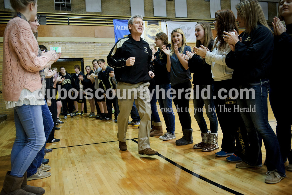 Jasper head coach Rick Stenftenagel ran out onto the floor after his team before their match against Southridge on Tuesday. Matthew Busch/The Herald