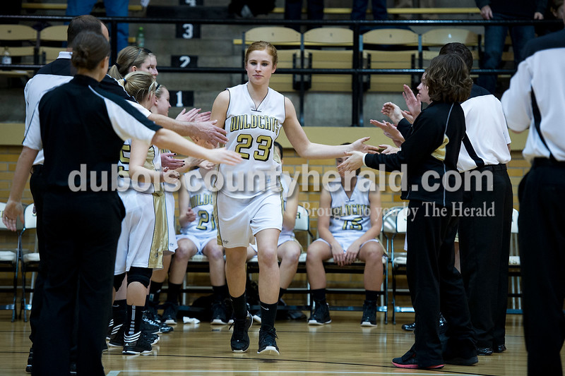 Jasper's Tori Sermersheim high-fived her teammates as she was called to the floor as a starter in Thursday's game against Castle. Matthew Busch/The Herald