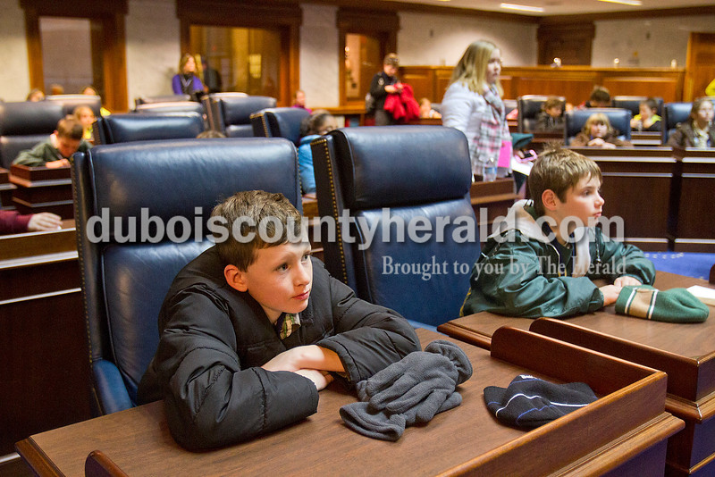 Ferdinand Elementary School fourth-graders Blake Hagedorn and Jake Begle listened intently to discussions by their classmates<br /> as the children held a debate on weather ice cream should be given out every Friday while on tour of the State Capitol after the inauguration ceremony on Jan. 14.
