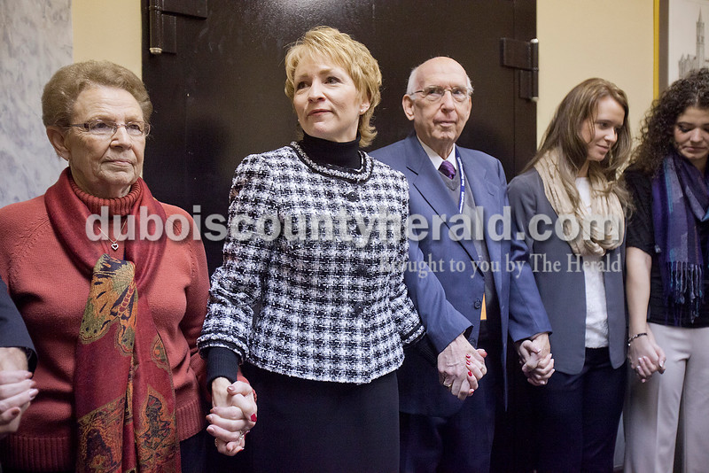 Surrounded by her parents, Betty and Tom Boeglin of Ferdinand, and other family members including daughter Laura Wirthwein of Columbus, second from right, and stepdaughter Grace Mehling of Ferdinand, far right, Lieutenant Governor Sue Ellspermann joined hands to pray for the future term in office as well as Governor Mike Pence before stepping out to be sworn in at the State Capitol on Jan. 14.
