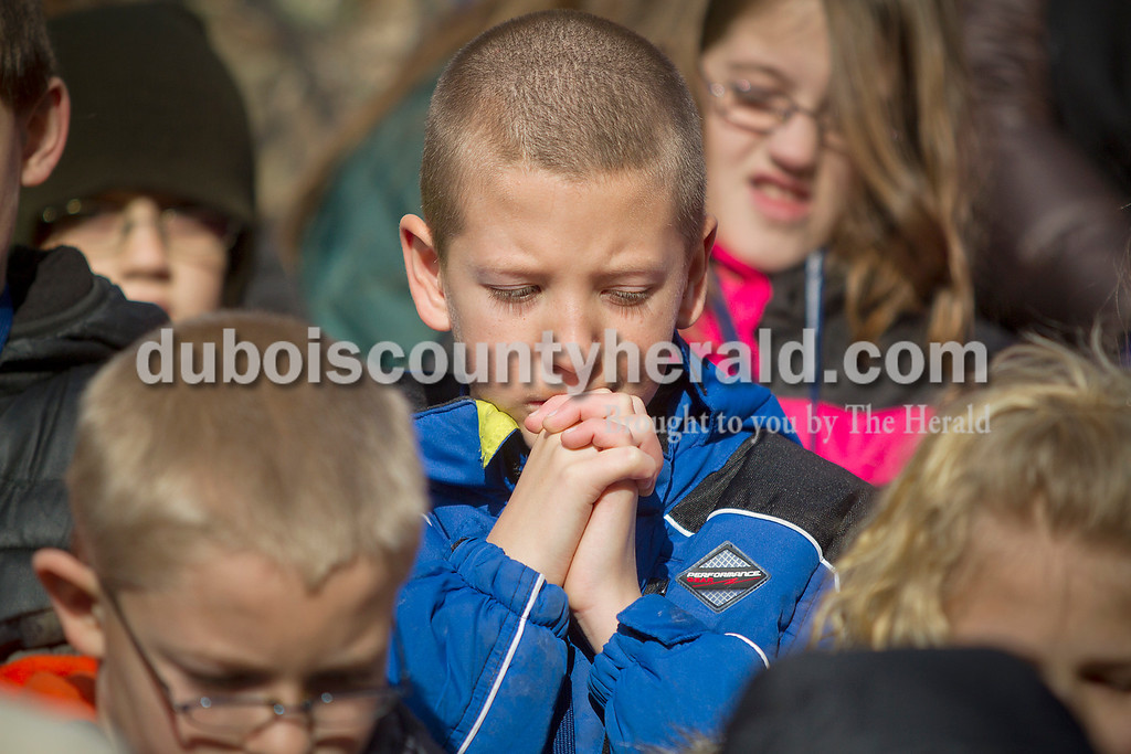 Ferdinand Elementary School fourth-grader Austin Clifton clasped his hands to pray during the invocation at the gubernatorial inauguration of  Lieutenant Governor Sue Ellspermann and Governor Mike Pence at the State Capitol on Jan. 14. Pine Ridge and Forest Park fourth-graders were invited to recite the Pledge of Allegiance during the ceremony.