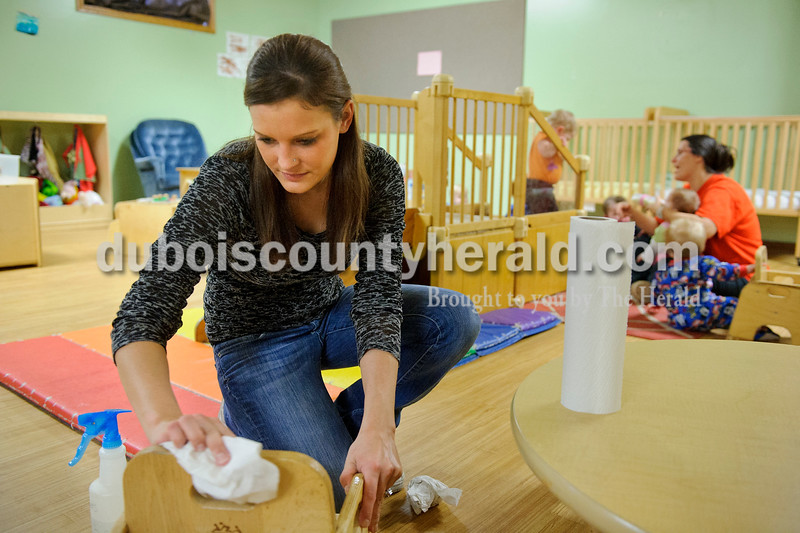 Matthew Busch/The Herald<br /> Sara Krisch, left, a teacher at HUMmingbird Day Care, washed a chair after snack time on Tuesday. Cleaning each room's toys, tables, chairs and mats after the children leave for the day can take up to an hour the teachers said. The teachers at HUMmingbird have begun taking extra preventative measures for protecting their students and themselves against the recent outbreak of the flu virus.