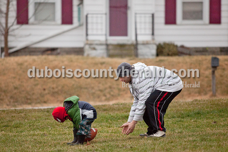 Rachel Mummey/The Herald<br /> Spencer Rust of Jasper, 3, haunched down to hike the ball to his older brother Weston, 21, across from their house on 15th Street in Jasper on Tuesday. They were also playing with their other siblings, Haydon, 16, and Akaysia, 10.