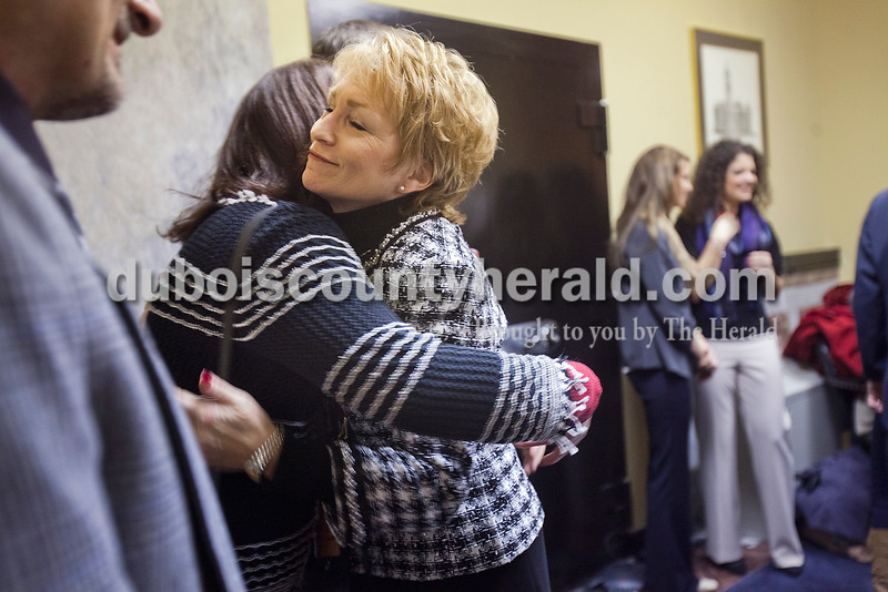 In the final minutes before the inauguration, Lieutenant Governor Sue Ellspermann received a hug from her cousin Connie Boeglin-Martin of Carmel at the State Capitol on Jan. 14. Connie said she always wished she could be more like Sue as they were growing up.