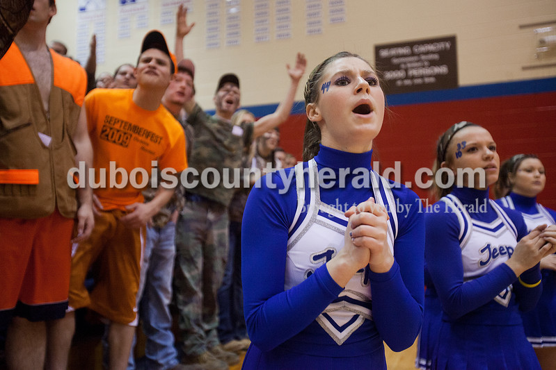 Rachel Mummey/The Herald<br /> Northeast Dubois cheerleader Haley Thewes, a junior, cheered on the Jeeps during the Class 1A girls sectional championship against Tecumseh in Lynnville on Saturday. Northeast Dubois won 49-42.