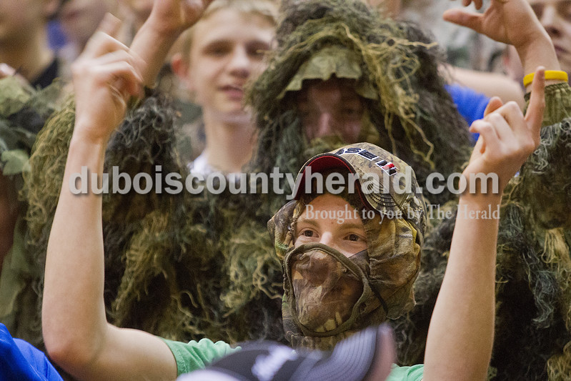 Rachel Mummey/The Herald<br /> Northeast Dubois senior Shelby Pieper cheered from the student section during the Class 1A girls sectional championship against Tecumseh in Lynnville on Saturday. Northeast Dubois won 49-42.