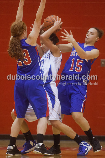 Rachel Mummey/The Herald<br /> Northeast Dubois' Rachel Breitwieser tried holding onto a rebounded ball against Tecumseh's Madison Oxley and Auriel Trible during the Class 1A girls sectional championship in Lynnville on Saturday. Northeast Dubois won 49-42.