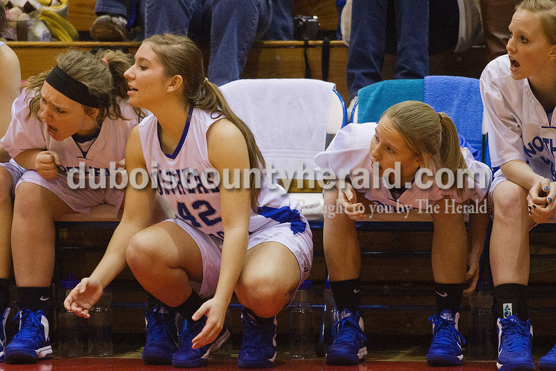 Rachel Mummey/The Herald<br /> Northeast Dubois' Talia Terwiske, Jenna Stemle, Taylor Bauer and Chloe Johnson watched intently from the sidelines during the Class 1A girls sectional championship against Tecumseh in Lynnville on Saturday. Northeast Dubois won 49-42.