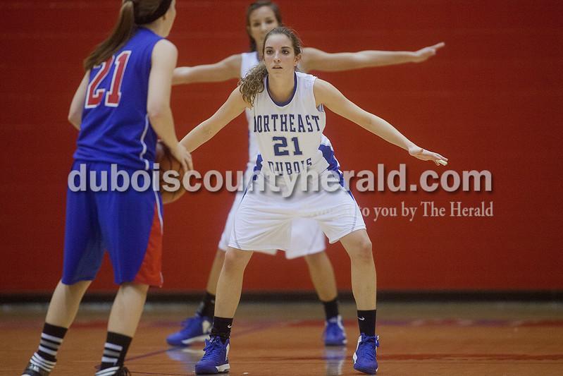 Rachel Mummey/The Herald<br /> Northeast Dubois' Emily Lueken defended against Tecumseh's Katie Burkett during the Class 1A girls sectional championship in Lynnville on Saturday. Northeast Dubois won 49-42.