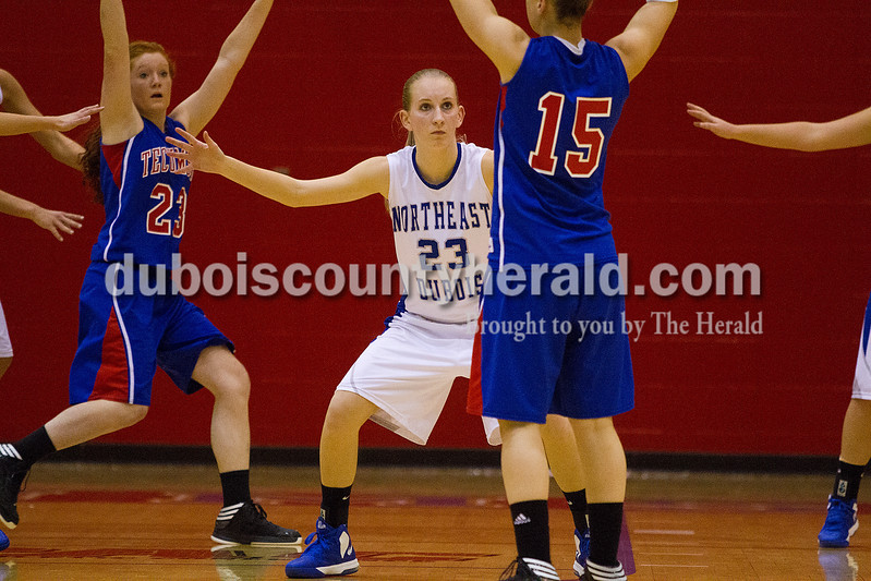 Rachel Mummey/The Herald<br /> Northeast Dubois' Nicole Dodd defended against Tecumseh's Auriel Trible during the Class 1A girls sectional championship in Lynnville on Saturday. Northeast Dubois won 49-42.