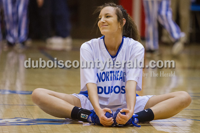 Rachel Mummey/The Herald<br /> Northeast Dubois' Rachel Breitwieser smiled as she stretched with her teammates before the start of the Class 1A girls sectional championship against Tecumseh in Lynnville on Saturday. Northeast Dubois won 49-42.
