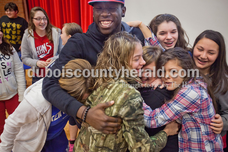 Rachel Mummey/The Herald<br /> Bully Bashers' Mike Jones of Cynthiana, Kent. received hugs from Heritage Hills eighth-grader Taylor Gorby, left, seventh-grader Kasey Schaeffer, Destinee Stepro, Karina Alvey, Madalyn Fuller and Justina Yanez after a presentation on how to prevent bullying at Heritage Hills High School on Friday. Jones and former Miss Teen America and current Miss Ohio Collegiate Katie Himes, also of Cynthiana, began an organization called Bully Bashers and have visited 20 schools in Kentucky to in attempts to stop bullying. Jones was bullied from age 8 to 14 because he liked to dance.