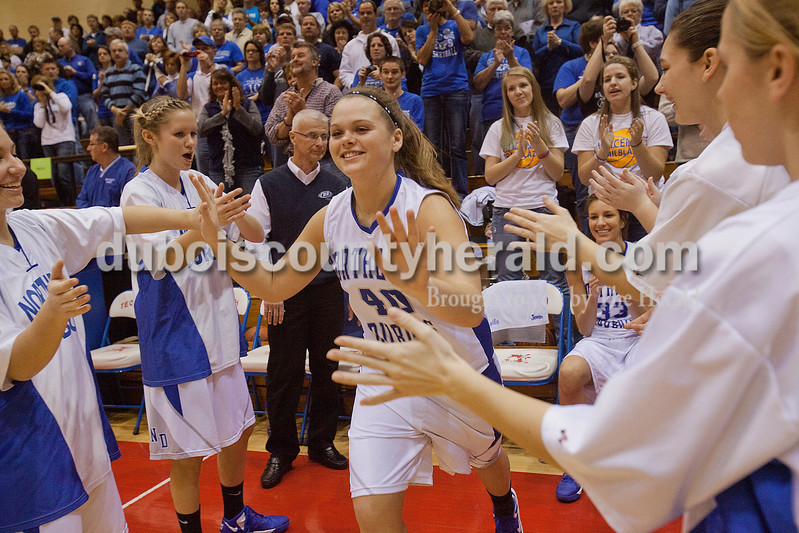 Rachel Mummey/The Herald<br /> Northeast Dubois' Haley Kinder high-fived her teammates during player introductions during the opening of the Class 1A girls sectional championship against Tecumseh in Lynnville on Saturday. Northeast Dubois won 49-42.