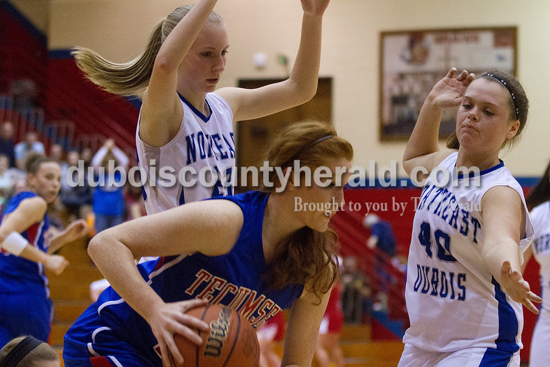 Rachel Mummey/The Herald<br /> Northeast Dubois' Nicole Dodd and Haley Kinder blocked Tecumseh's Madison Oxley on a rebound during the Class 1A girls sectional championship in Lynnville on Saturday. Northeast Dubois won 49-42.