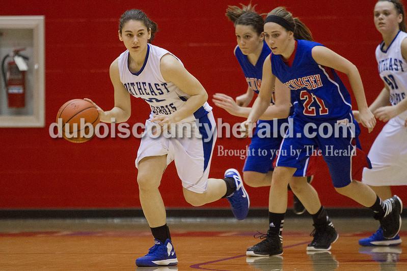 Rachel Mummey/The Herald<br /> Northeast Dubois' Brynn Hoffman dribbled the ball downcourt past Tecumseh's Katie Burkett during the Class 1A girls sectional championship in Lynnville on Saturday. Northeast Dubois won 49-42.