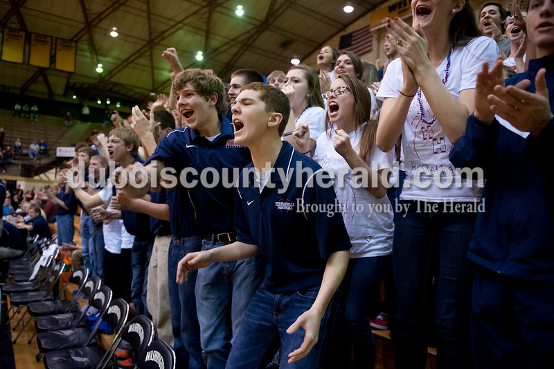 Heritage Hills' student section cheered in the fourth quarter after their team got a chance to tie the score during Tuesday's Class 3A boys sectional against Jasper at The Hatchet House gymnasium in Washington. The Wildcats won 81-69 in overtime. Matthew Busch/The Herald