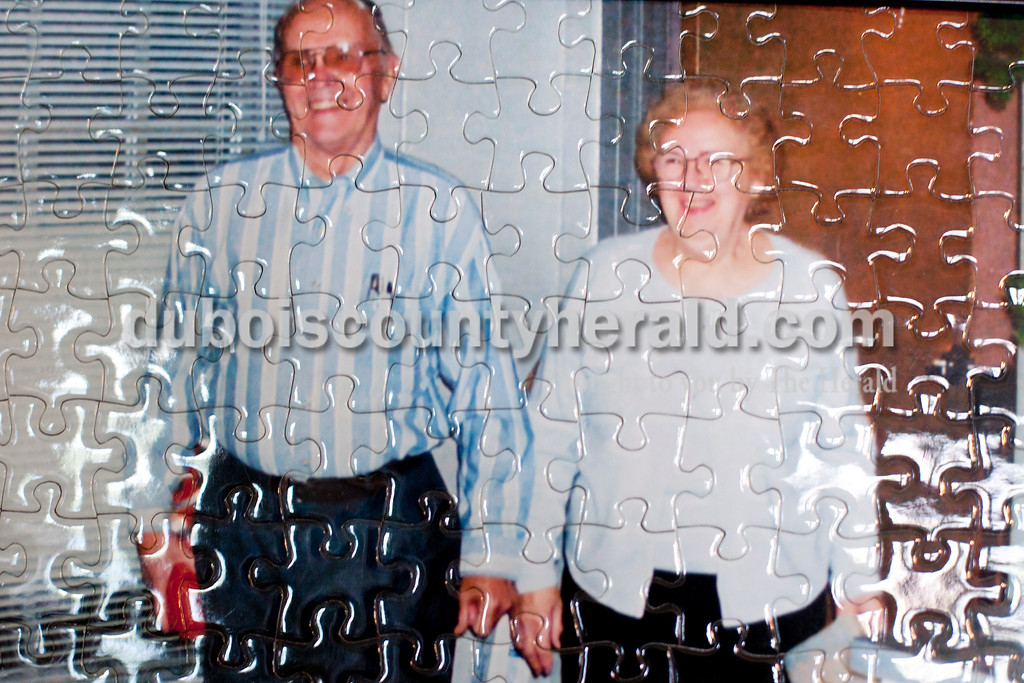 """Dave Weatherwax/The Herald<br /> A photograph of Reynold """"Lenny"""" Knust, 86, and his wife, Leona, 82, that was taken on Lenny's 80th birthday was transformed into a puzzle and now hangs in their home."""