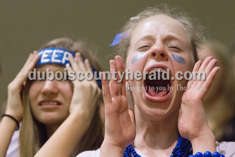 Rachel Mummey/The Herald<br /> Northeast Dubois seventh-grader Kortney Quinn screamed during an Evansville Day free throw attempt during Tuesday's Class 1A boys sectional at Wood Memorial Gymnasium in Oakland City. Northeast Dubois won 64-48.