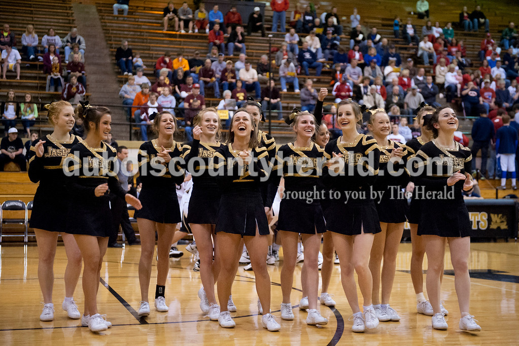 The Jasper cheerleaders shared a laugh after they complete a routine during Tuesday's Class 3A boys sectional against Heritage Hills at The Hatchet House gymnasium in Washington. The Wildcats won 81-69 in overtime. Matthew Busch/The Herald