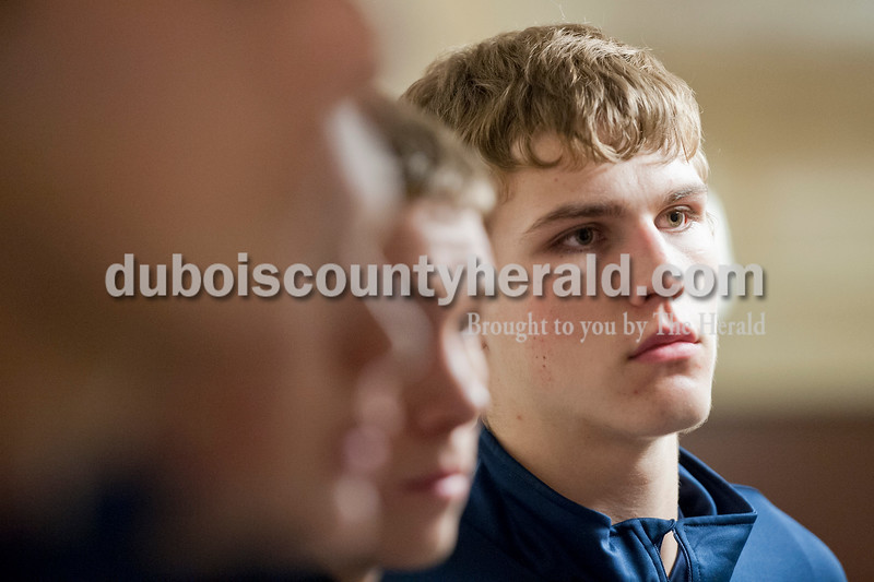 Heritage Hills' Caleb Sabelhaus listened to head coach Matt Sisley in their locker room before the start of Tuesday's Class 3A boys sectional against Jasper at The Hatchet House gymnasium in Washington. The Wildcats won 81-69 in overtime. Matthew Busch/The Herald