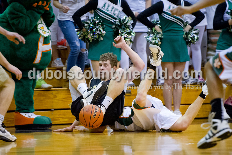 Jasper's Nick Gobert dove to the ground after a loose ball during Saturday's Class 3A boys sectional championship game against Vincennes Lincoln at the Hatchet House in Washington. The Wildcats lost 48-25. Matthew Busch/The Herald
