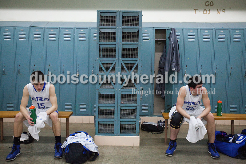 Rachel Mummey/The Herald<br /> Northeast Dubois' Wade Friedman and Jace Terwiske rested in the locker room at halftime during Saturday night's Class 1A sectional championship against Tecumseh in Oakland City. Northeast Dubois won in overtime 69-60.