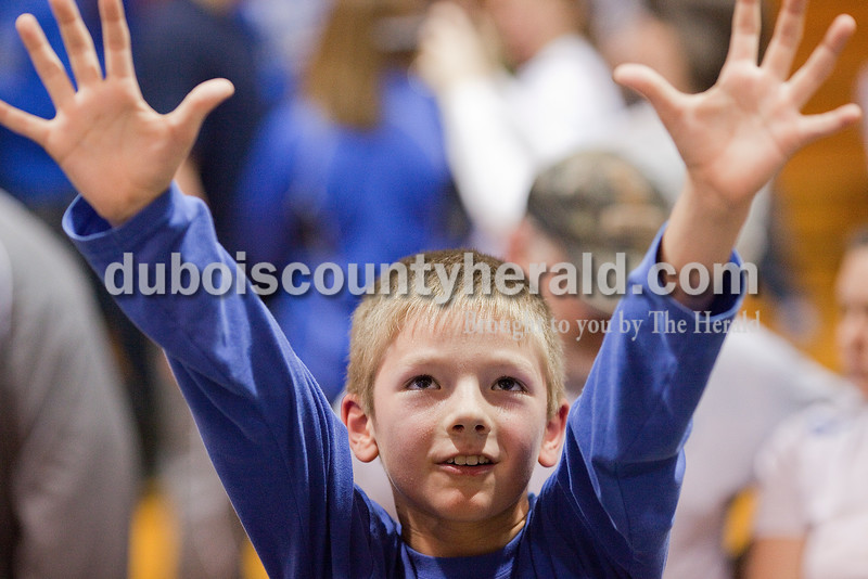 Rachel Mummey/The Herald<br /> Colby Pieper of Celestine, 8, rose his hands in hopes of getting a piece of the sectional net after defeating Tecumseh in Saturday night's Class 1A sectional championship in Oakland City. Northeast Dubois won in overtime 69-60.