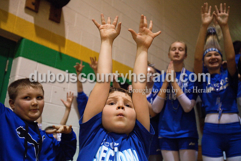 Rachel Mummey/The Herald<br /> Colby Stafford of Dubois, 11, center, pressed his arms up into the air with Ty Riecker of Celestine, 10, left, while Alex Dodson of Dubois, 13, prayed next to Kyndal Green on Dubois, 13, right, during Saturday night's Class 1A sectional championship against Tecumseh in Oakland City. Northeast Dubois won in overtime 69-60.