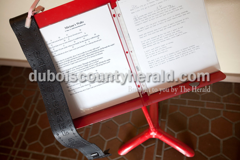 Dave Weatherwax/The Herald<br /> A music stand holding two of Paul Michael Ash's original songs sat in the entry way of Becher Funeral Home in Ferdinand on Monday during Ash's visitation.