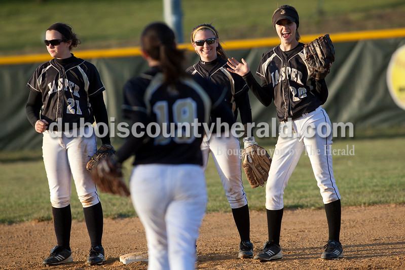 Jasper's Paige Werner, second from left, was welcomed onto the field by teammates Emily Beckman, left, Samantha Gerber and Katie Krempp at the start of Tuesday night's game against Heritage Hills in Jasper. The Wildcats defeated the Patriots 4-1.Dave Weatherwax/The Herald