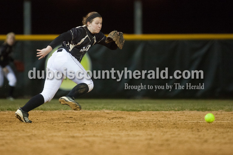 Jasper's Emily Beckman was unable to chase down a ground ball hit into center field during Tuesday night's game against Heritage Hills in Jasper. The Wildcats defeated the Patriots 4-1.Dave Weatherwax/The Herald
