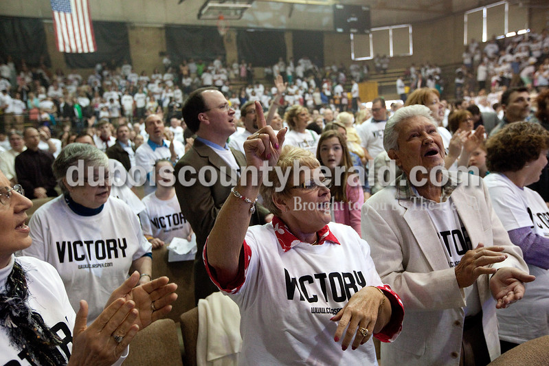 """Lois Mason of Huntingburg, second from right, and her husband, Ron, joined in singing Johnny Cash's arrangement of Hank Williams' song """"I Saw the Light"""" at the close of the Christian Church of Jasper's Easter service held Sunday morning at the Cabby O'Neill Gymnasium in Jasper. Dave Weatherwax/The Herald"""