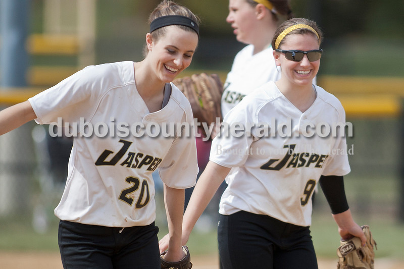 Matthew Busch/The Herald<br /> Jasper's first baseman Katie Krempp, left, and second baseman Samantha Gerber, walked back to their positions after a team huddle at the mound during Jasper's game Saturday against Barr-Reeve. The Wildcats won the game 8-3.