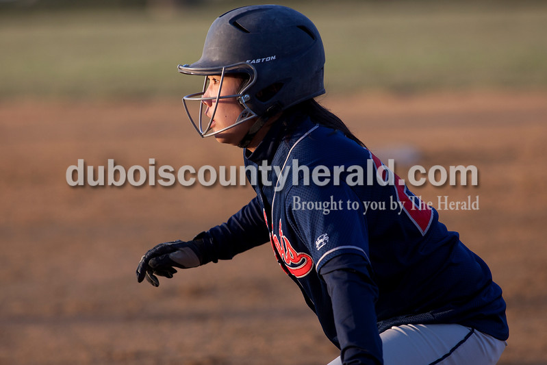 Heritage Hills' Hayli Scott kept an eye on Jasper catcher Jessie Gudorf as she took a lead off of first base during Tuesday night's game in Jasper. The Wildcats defeated the Patriots 4-1.Dave Weatherwax/The Herald