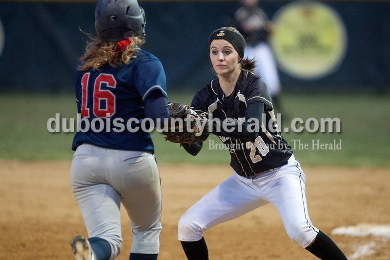 Jasper's Katie Krempp, left, applied the tag to Heritage Hills' Abby Fischer during Tuesday night's game in Jasper. The Wildcats defeated the Patriots 4-1.Dave Weatherwax/The Herald