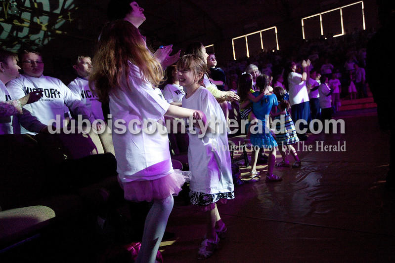 Isabella Ross of Jasper, 10, left, danced to the music with her sister, Gabrielle, 7, during the Christian Church of Jasper's Easter service Sunday morning at Cabby O'Neill Gymnasium in Jasper. Dave Weatherwax/The Herald