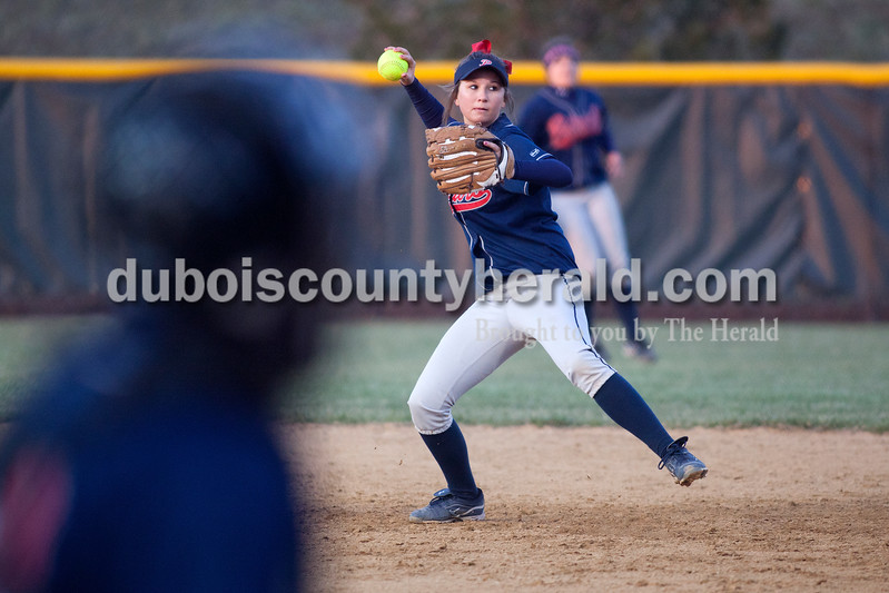 Heritage Hills' Kaylee Zoglman made a throw to first base to catch the Jasper runner during Tuesday night's game in Jasper. The Wildcats defeated the Patriots 4-1.Dave Weatherwax/The Herald