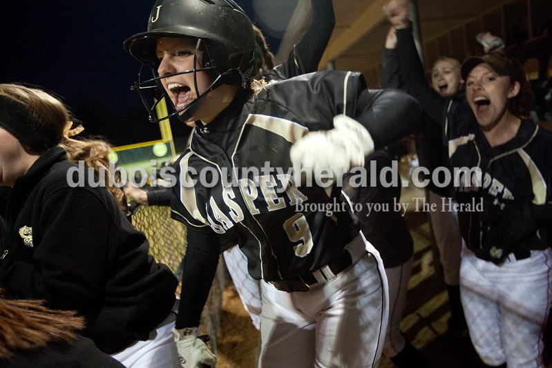 Jasper's Samantha Gerber celebrated with her teammates in the dugout as they added to their lead over Heritage Hills after scoring one of three runs in the sixth inning of Tuesday night's game in Jasper. The Wildcats defeated the Patriots 4-1.Dave Weatherwax/The Herald