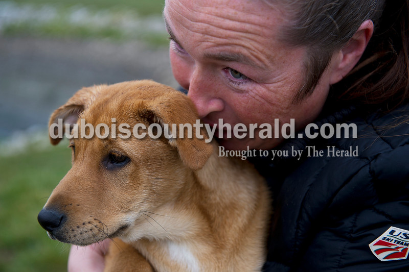 Matthew Busch/The Herald<br /> Monica Leitch of Huntingburg held Laney outside the Huntingburg Humane Society center where they held a dog Easter egg hunt Sunday morning using hard-boiled eggs that the dogs could eat.