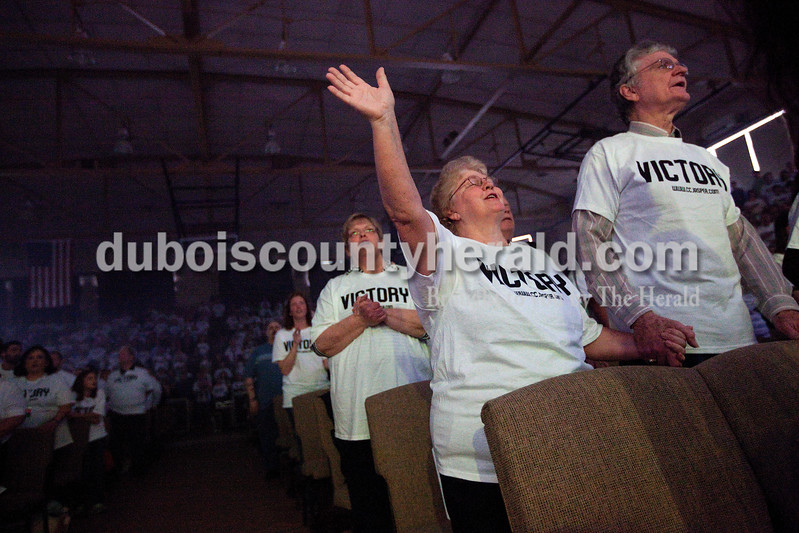 Glenda McLean of Huntingburg, second from left, and her husband, Kenneth, sang along during the Christian Church of Jasper's Easter service message Sunday morning at Cabby O'Neill Gymnasium in Jasper. Dave Weatherwax/The Herald