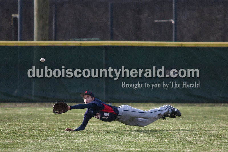Heritage Hills' Kenton Crews dove for a fly ball in center field during Heritage Hills' game against Loogootee Wednesday night in Lincoln City. Matthew Busch/The Herald