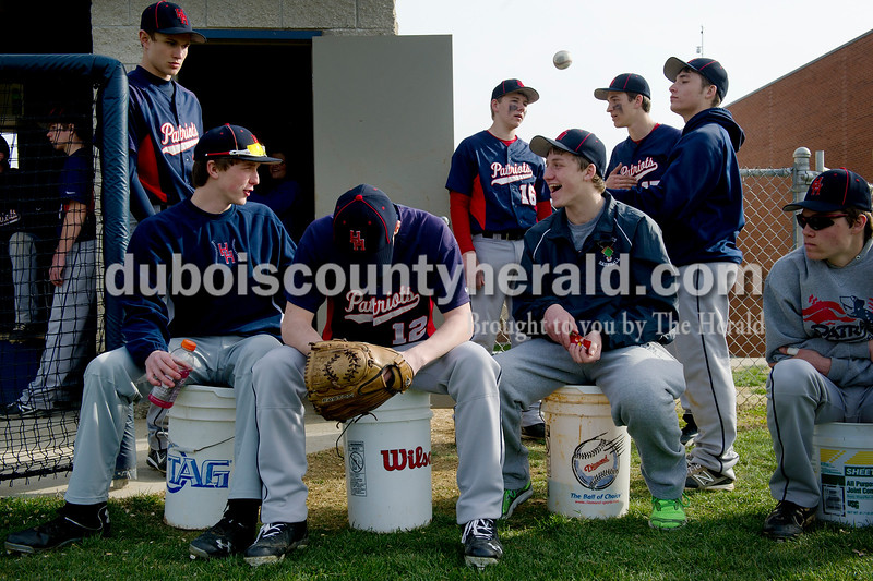 Heritage HIlls' Kenton Crews, left, Tyler Ward, Torrin Madden, Jame Ramsey, Logan Wilerson, Tyler Tischendorf, Drew Grass, and Nick Waninger talked amongst themselves as the Loogootee team warmed up on the field during Heritage Hills' game Wednesday night in Lincoln City. Matthew Busch/The Herald