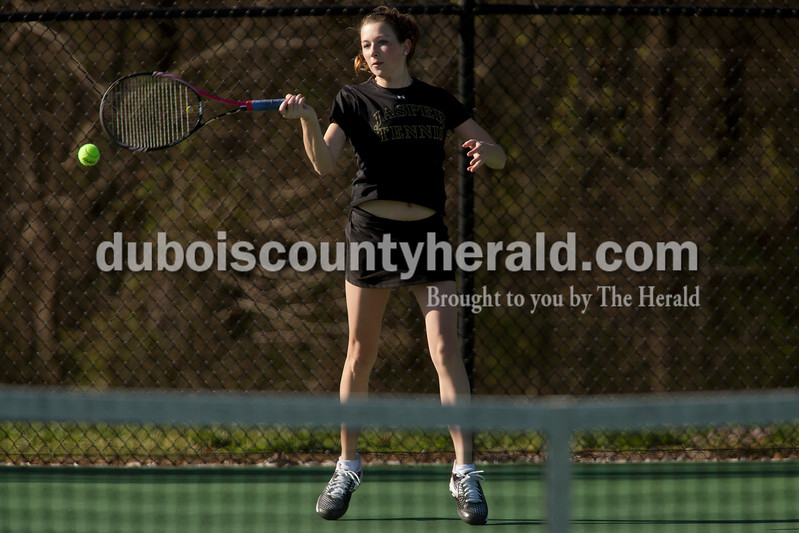 Jasper's Maria Lueken returned the serve during the No. 2 singles match of Saturday's match against Greenwood in Jasper. Dave Weatherwax/The Herald