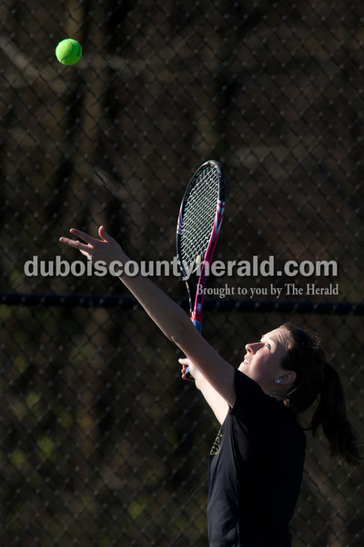 Jasper's Maria Lueken served the ball during the No. 2 singles match of Saturday's match against Greenwood in Jasper. Dave Weatherwax/The Herald